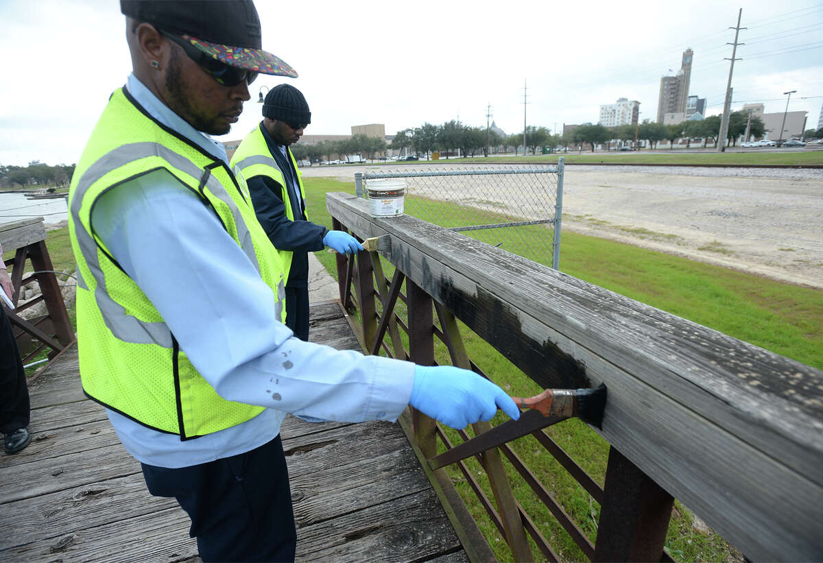City of Beaumont crewmen cover up anti-Semitic graffiti from a bridge at Riverfront Park on Monday. Photo taken February 06, 2017 Guiseppe Barranco/The Enterprise
