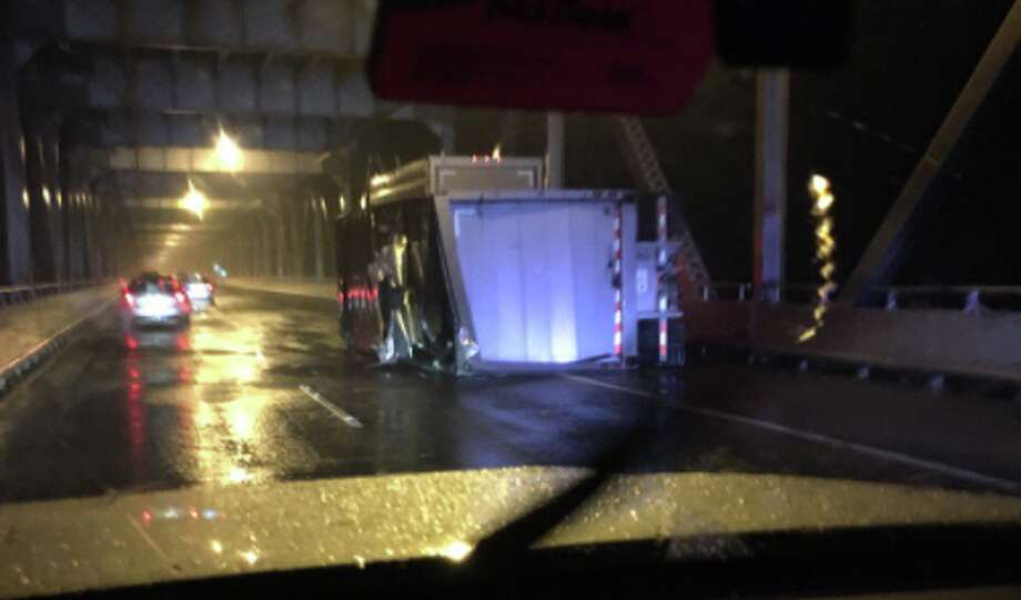 A strong gust of wind blew over a UPS truck on the Richmond San Rafael Bridge on Tuesday morning. Photo: Mike Mibach / KTVU