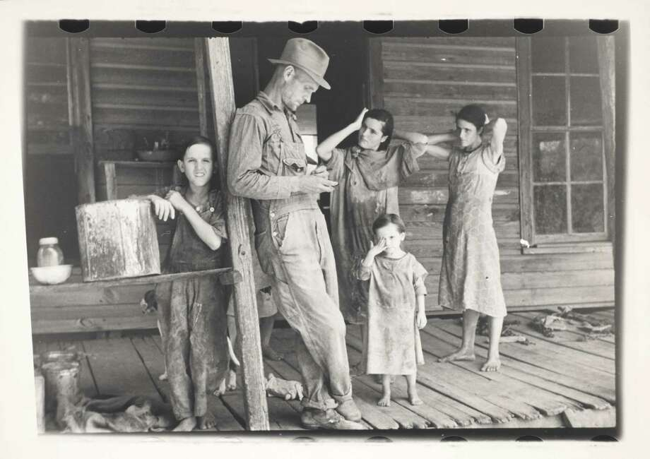 Floyd Burroughs and the Tengle Children, Hale County, Alabama, 1936. Walker Evans (American, 1903-1975). Gelatin silver print, 8 1/8 x 5 9/16 inches. Photo: Courtesy Harry Ransom Center
