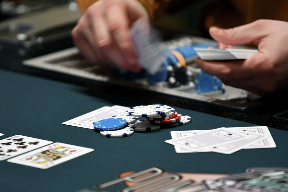 Dealer deals cards at poker game in Rivers Casino & Resort Schenectady on Wednesday, Feb. 1, 2017, during a media tour in Schenectady, N.Y. The game was used as a training exercise for casino employees using faux money. (Will Waldron/Times Union) Photo: Will Waldron / 20039576A
