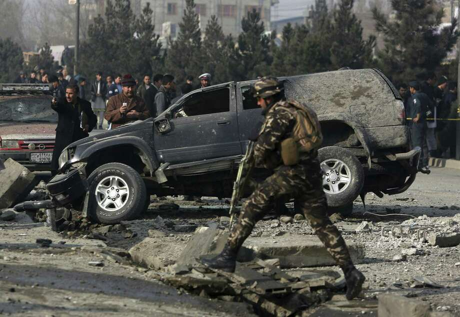 FILE - In this Wednesday, Dec. 28, 2016, file photo, Afghan security personnel inspect the site of roadside bomb blast in Kabul, Afghanistan. The U.N. mission in Afghanistan says the number of civilian casualties in the country's conflict rose by 3 percent in 2016. The U.N. 2016 Annual Report on the Protection of Civilians in Armed Conflict in Afghanistan was released Monday, Feb. 6, 2017. (AP Photo/Rahmat Gul, File) Photo: Rahmat Gul, STF / Associated Press / Copyright 2016 The Associated Press. All rights reserved.