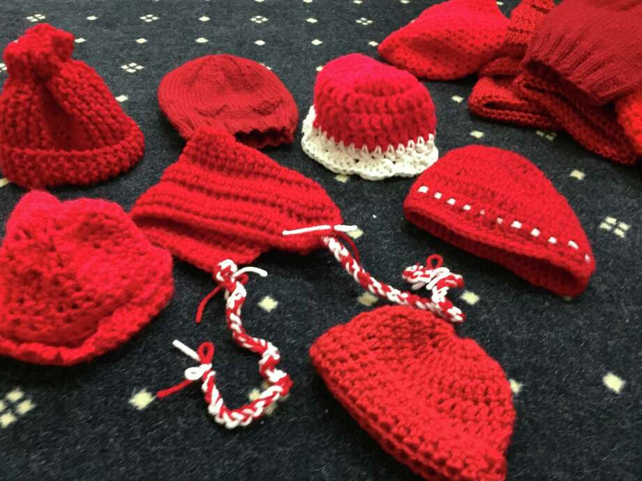 "Some of the hats donated to St. Vincent's Medical Center in Bridgeport as part of the American Heart Association's ""Little Hats, Big Hearts"" program. Photos courtesy of St. Vincent's Medical Center. Photo: Contributed / Contributed"