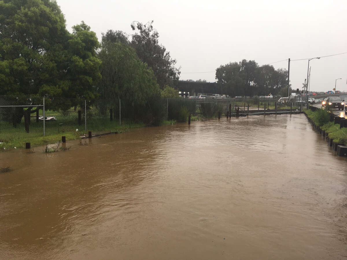 The San Rafael Creek floods on Tuesday during an early morning downpour.