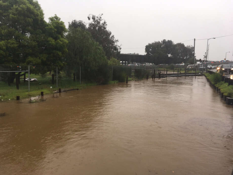 The San Rafael Creek floods on Tuesday during an early morning downpour. Photo: William Disbrow