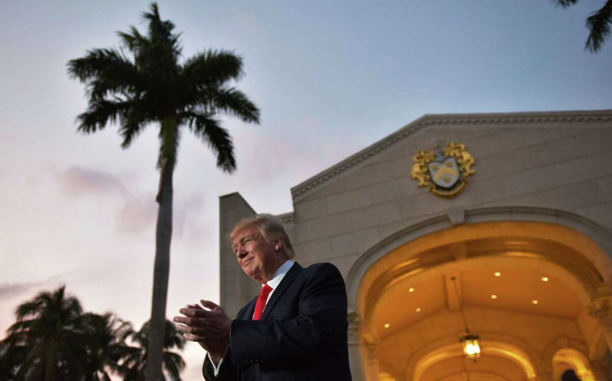 US President Donald Trump applauds as he is greeted by the Palm Beach Central High School marching band upon arrival to watch the Super Bowl at Trump International Golf Club Palm Beach in West Palm Beach, Florida on February 5, 2017. / AFP PHOTO / MANDEL NGANMANDEL NGAN/AFP/Getty Images