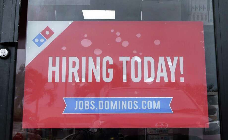 The Labor Department said job openings were flat at 5.5 million in December. Total hiring rose slightly to 5.25 million, while the number of people quitting fell. Photo: Alan Diaz /Associated Press / Copyright 2016 The Associated Press. All rights reserved.