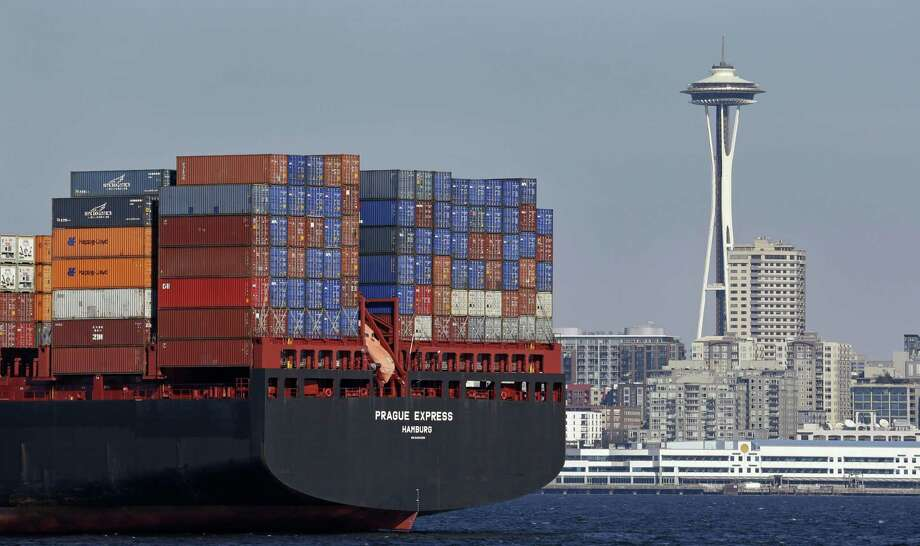 The Space Needle towers in the background Feb. 15 beyond a container ship anchored in Elliott Bay near downtown Seattle. A board member of the American Chamber of Commerce in China, Lester Ross, says China is preparing to retaliate if U.S. President-elect Donald Trump carries out promises to impose sanctions on Chinese goods. Photo: Elaine Thompson /Associated Press / Copyright 2016 The Associated Press. All rights reserved.