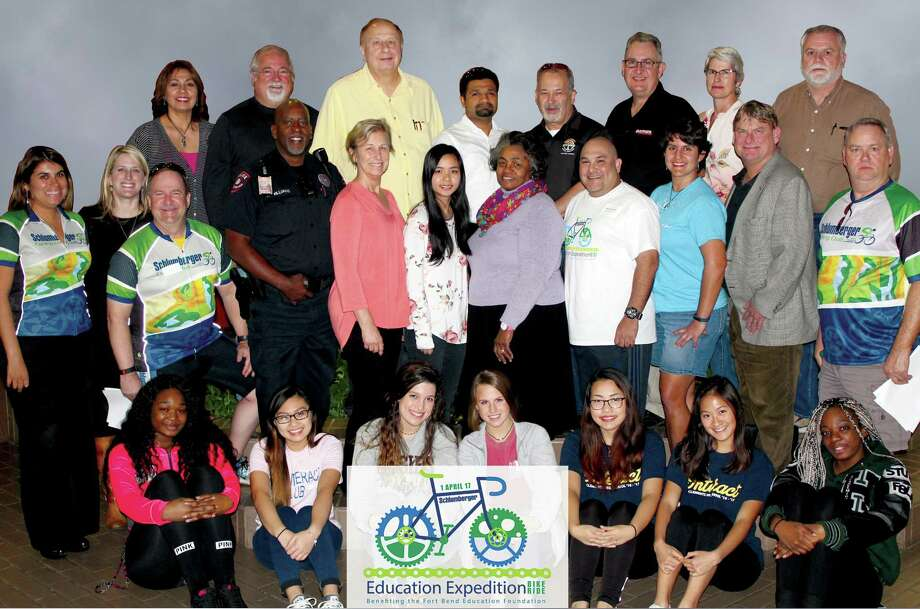 Fort Bend Education Foundation will host its 14th annual bike ride on April 1. Bike Ride committee members include, from left, front row: Students from Hightower High School Interact Club, Kempner High School Interact Club, Ridge Point High School Student Council and Clements Interact Club; second row: Eunice Mather; FBEF Marketing Coordinator Hillary Dunn; Bill Dillon; Ron Williams; Margaret Constance; Tonya Samuels; Frankie Jackson; Ronnie Escobar; Joanna Covington; Matt Brown and Jim Mayes; third row: Terri Hernandez; FBEF Board Member Ron Bailey; FBEF Past President John Wantuch; Co-Ride Director Akhil Kulkarni; Co-Ride Director Charles Borsos; FBEF Board Member Scott Maddox, Janice Holley and Geir Bentzen Photo: Fort Bend Education Foundation