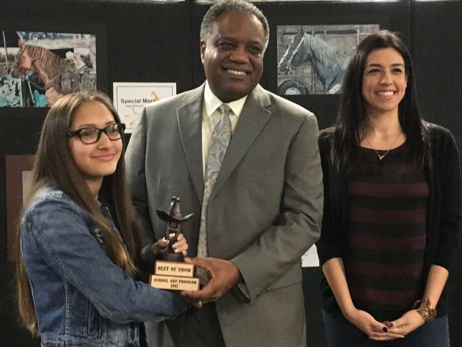 Reading Junior High eighth-grader Alex Velasquez won best of show in the Lamar Consolidated ISD art contest. She is congratulated by Lamar Consolidated Independent School District Superintendent Thomas Randle. Her art teacher, right, is Monica Arratia. Photo: Karen Zurawski