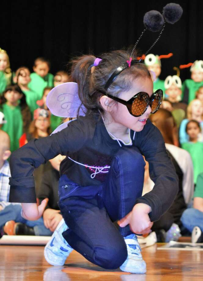 """As part of their annual program, kindergarten students from Needville Elementary sang """"Shoo Fly, Don't Bother Me"""" as flies buzzed the stage at the high school auditorium. Among them was Hailey Escamilla, who was ready to take off at any given moment. Photo: Needville ISD"""