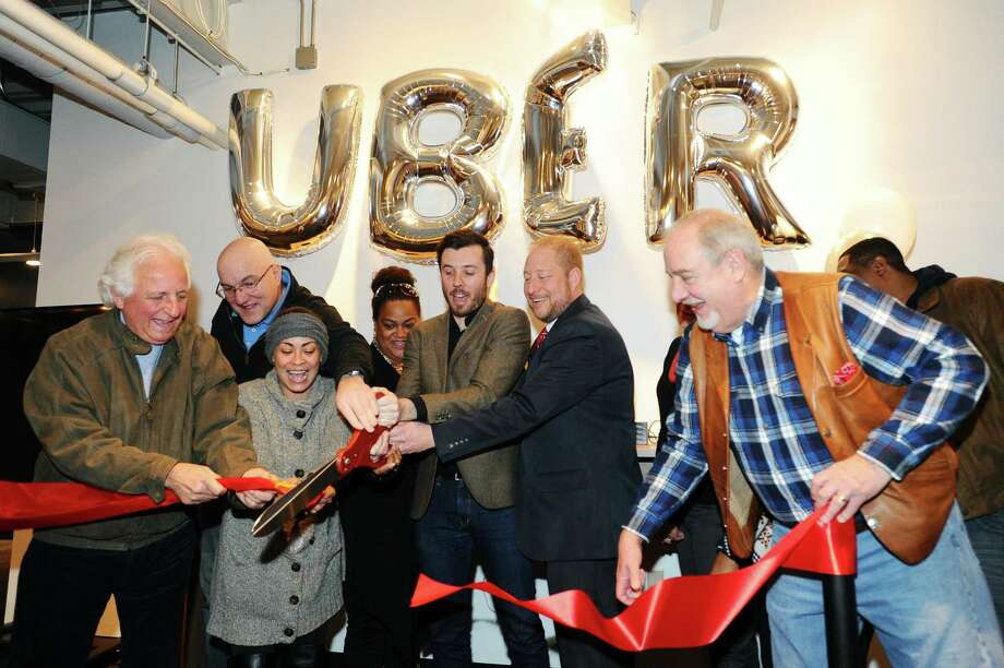 Uber General Manager Matt Powers, center, leads the ribbon cutting for the new Greenlight Hub for Uber driver-partners in Stamford, Conn. on Tuesday, Feb. 7, 2017. Photo: Michael Cummo / Hearst Connecticut Media / Stamford Advocate