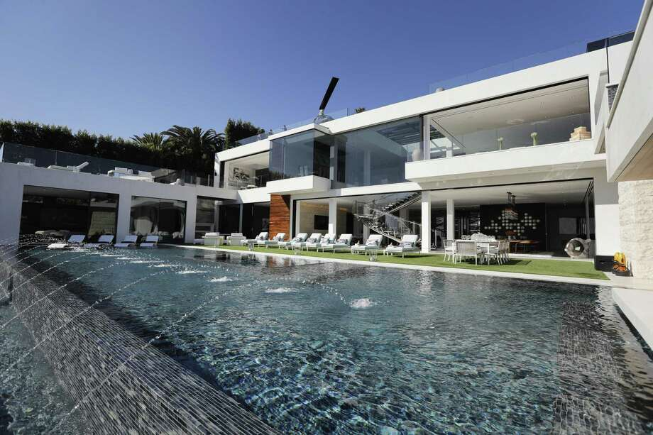 This $250 million mansion in the Bel-Air neighborhood of Los Angeles features a 85-foot infinity swimming pool. Reams of data have shown that in recent decades the rich have been taking ever-larger shares of wealth and income — especially in the U.S., where corporate profits are nearing records while wages for the workforce remain stagnant. Photo: Jae C. Hong /Associated Press / Copyright 2017 The Associated Press. All rights reserved.