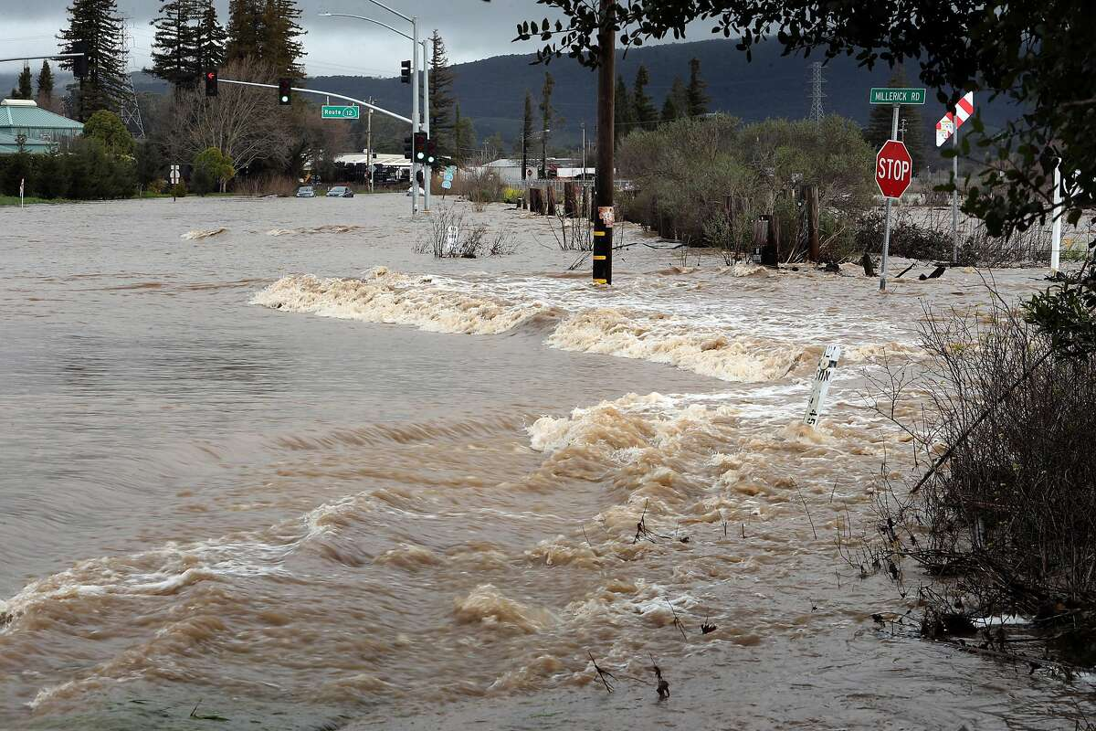 The intersection of Routes 12 and 121is overrun with floodwaters in Sonoma, Calif., on Tuesday, February 7, 2017.