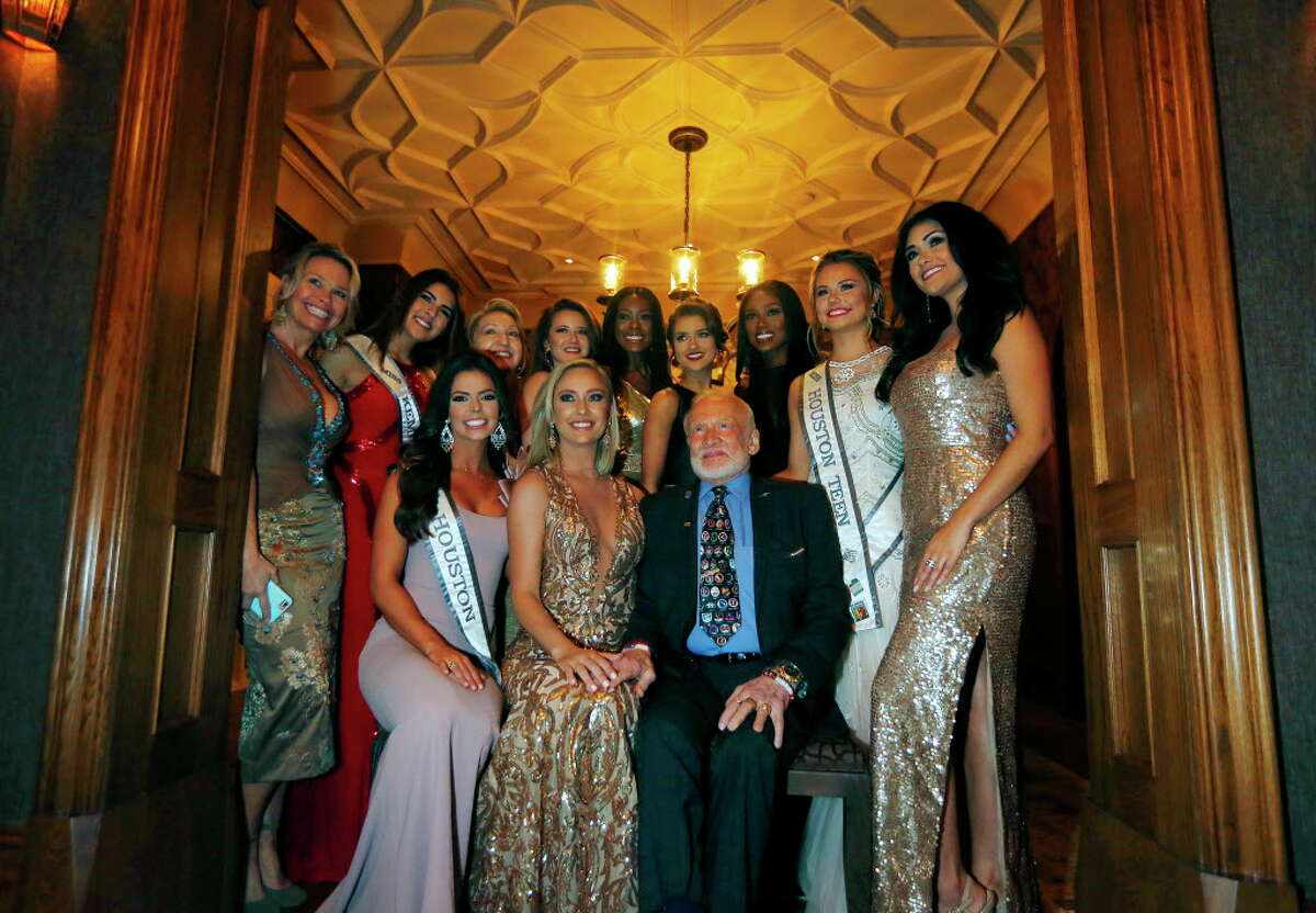 Astronaut Buzz Aldrin and Texas beauty pageant contestants during Joanne King Herring's Extravaganza of the Stars on Saturday, Feb. 4, 2017, at the Blackburn Estate in Houston. (Annie Mulligan / Freelance)