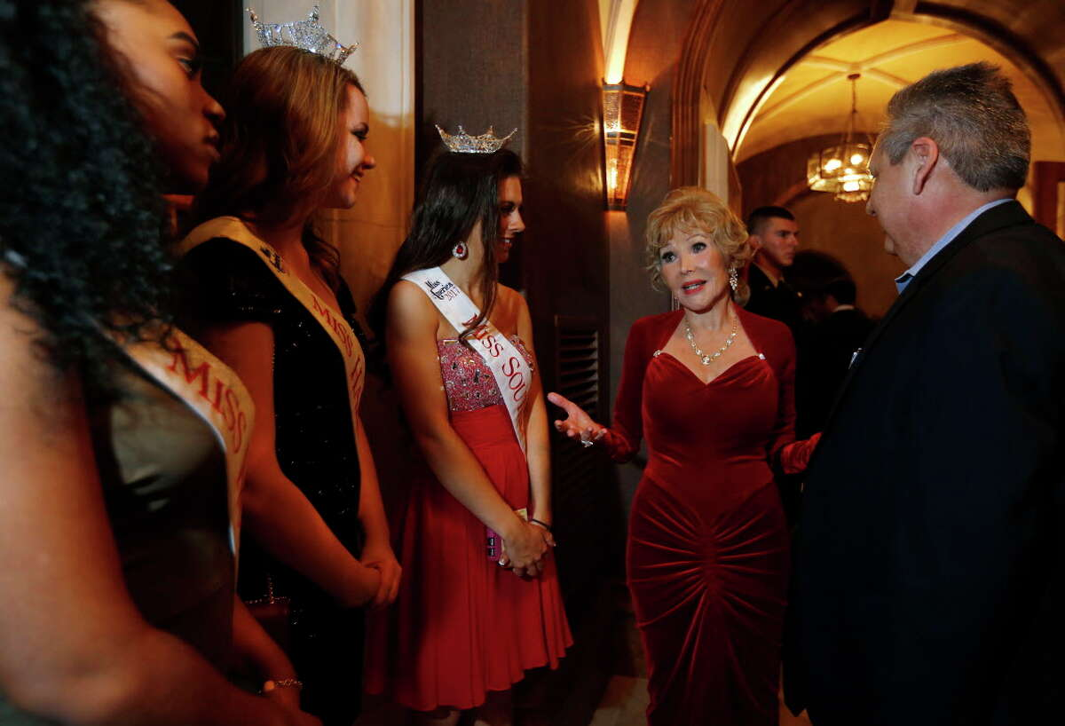 Joanne King Herring chats with beauty pageant contestants at the Extravaganza of the Stars on Saturday, Feb. 4, 2017, at the Blackburn Estate in Houston. (Annie Mulligan / Freelance)