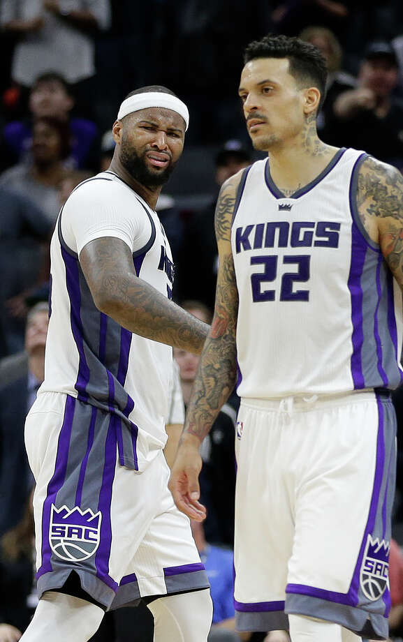 Sacramento Kings forward DeMarcus Cousins, left, glares at referee Tyler Ford after he was called for his second technical could during the second half of an NBA basketball game against the Chicago Bulls Monday, Feb. 6, 2017, in Sacramento, Calif. The Bulls won 112-107. At right is Kings forward Matt Barnes. (AP Photo/Rich Pedroncelli) Photo: Rich Pedroncelli, Associated Press / Copyright 2017 The Associated Press. All rights reserved.