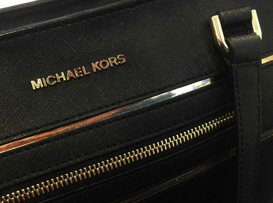 Michael Kor's third-quarter revenue was driven lower by weak sales in Europe and the Americas. Comparable store sales fell and the luxury retailer lowered its outlook for all of 2017. Photo: Associated Press / AP