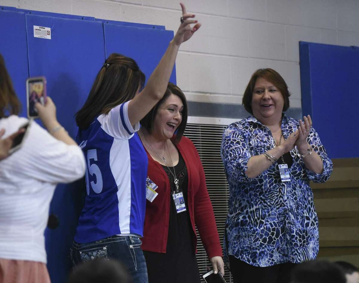 Amber Simpson, master teacher at Barrera Veterans Elementary School in the Somerset Independent School District, reacts after being named as the recipient of the $25,000 Milken Educator Award on Tuesday, Feb. 7, 2017.