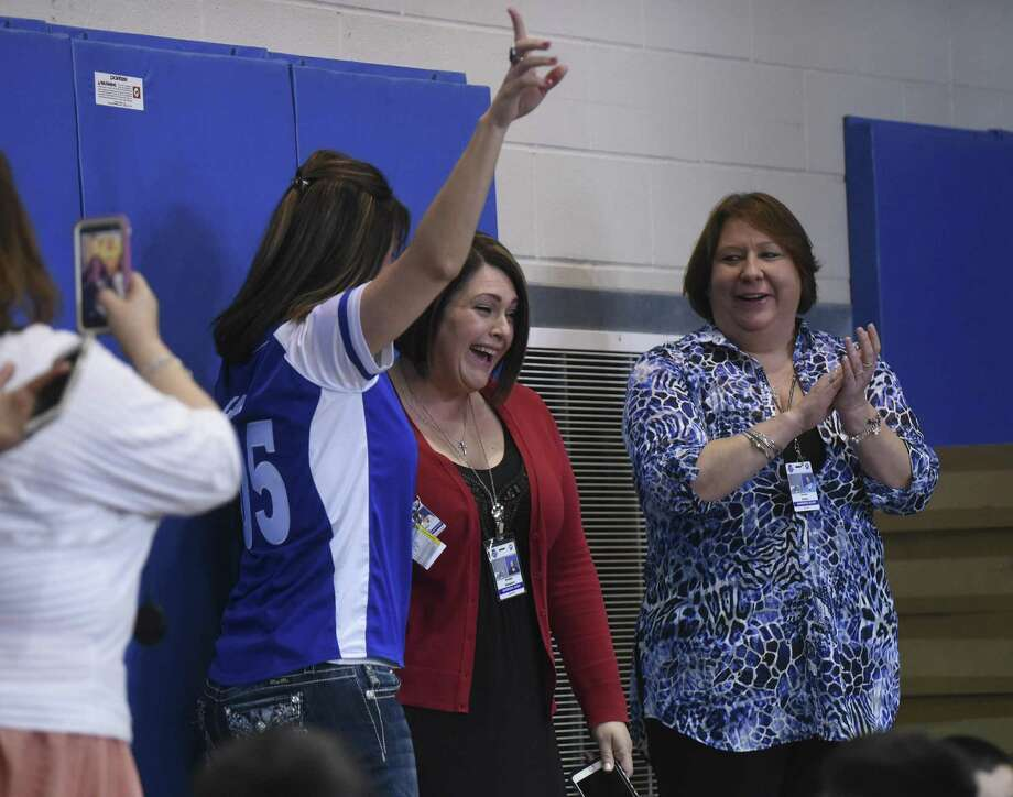 Amber Simpson, master teacher at Barrera Veterans Elementary School in the Somerset Independent School District, reacts after being named as the recipient of the $25,000 Milken Educator Award on Tuesday, Feb. 7, 2017. Photo: Billy Calzada, Staff / San Antonio Express-News / San Antonio Express-News