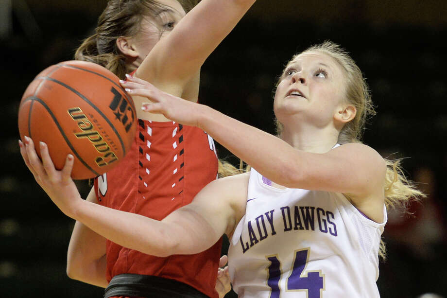 Midland High's Taysha Rushton (14) shoots against Amarillo Tascosa's Madison Moore (23) on Tuesday, Jan. 31, 2017, at Chaparral Center.  James Durbin/Reporter-Telegram Photo: James Durbin