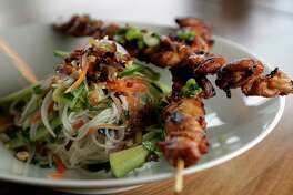 Grilled Chicken Summer Vermicelli, grilled chicken thigh meat skewers, vermicelli, mixed Asian herbs served slightly chilled at Maba Pan-Asian Diner Dec. 29, 2016, in Houston. ( James Nielsen / Houston Chronicle )