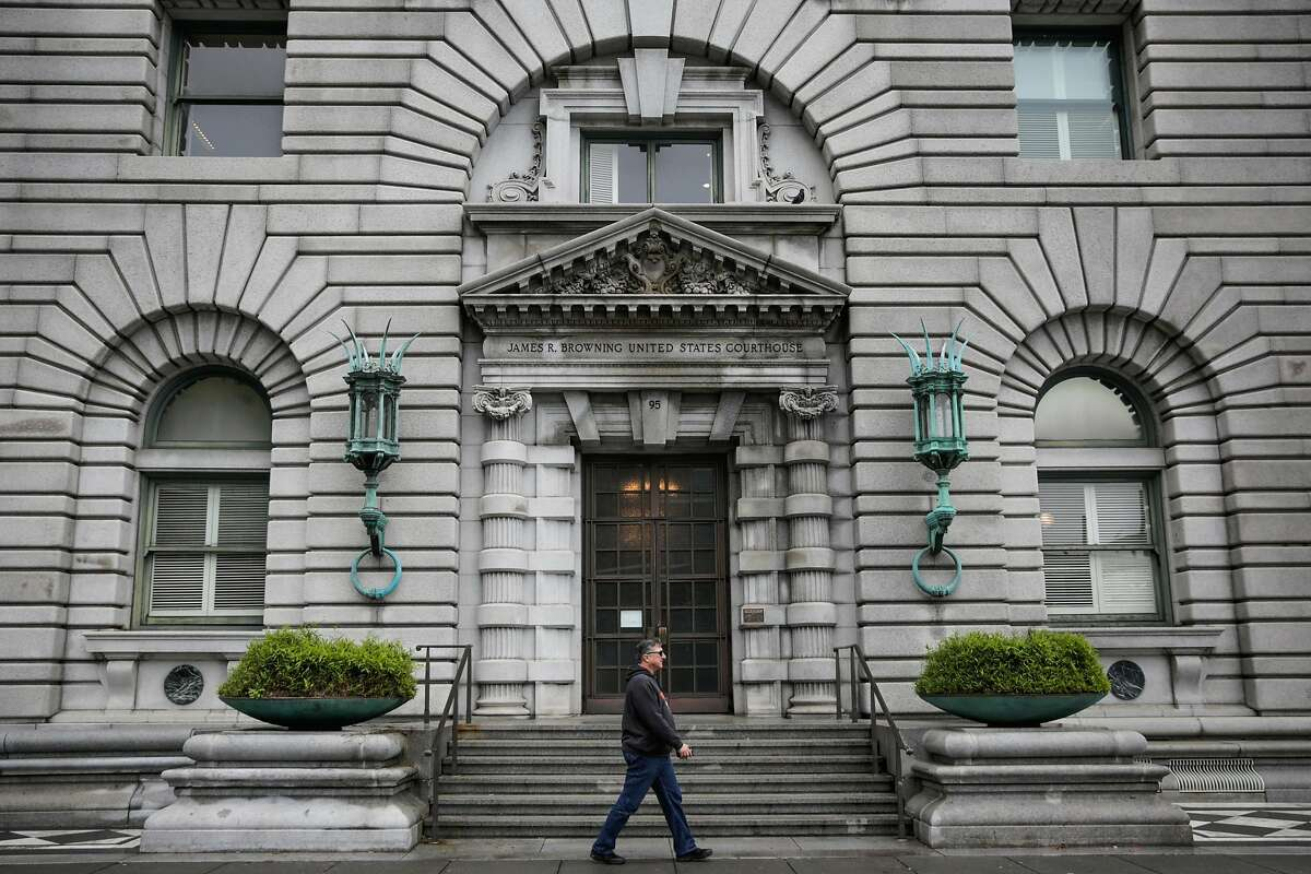 A pedestrian walks past the Ninth Circuit Court of Appeals which will be hearing the travel ban case this afternoon, in San Francisco, California, on Tuesday, Feb. 7, 2017.