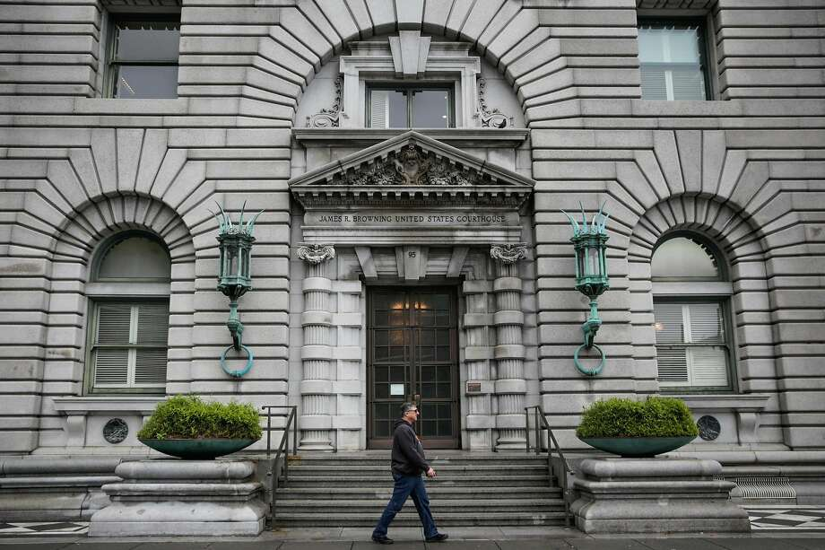 A pedestrian walks past the Ninth Circuit Court of Appeals which will be hearing the travel ban case this afternoon, in San Francisco, California, on Tuesday, Feb. 7, 2017. Photo: Gabrielle Lurie / The Chronicle