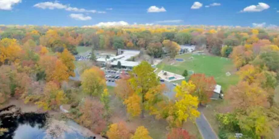 An aerial shot of Whitby shows the school's new land acquisition of 5.3 acres, located in the center of the photo behind the school. Photo: Contributed