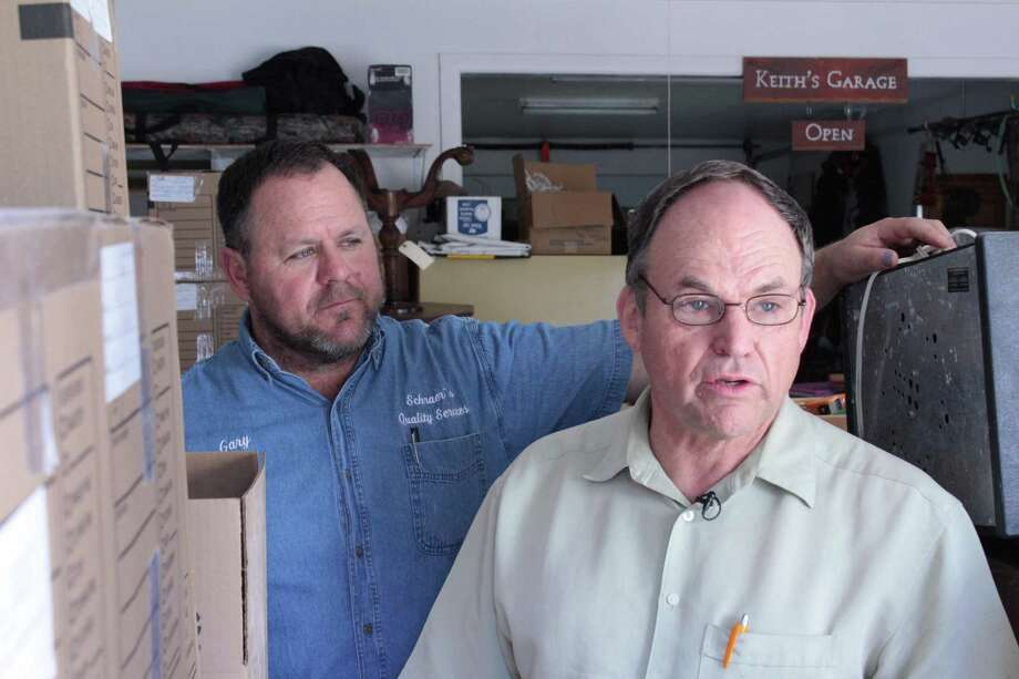Lavoin Keith Allison, right, came home to find his home flooded after a San Antonio Water System main break on Jan. 14. Three weeks later, SAWS only wants to pay for the cost of drying his house with industrial blowers, plus a $2,500 payment. His neighbor, construction contractor Gary Schraer, left, is helping him put his home back together Allison said repairs might cost up to $50,000. Photo: Brendan Gibbons /San Antonio Express-News