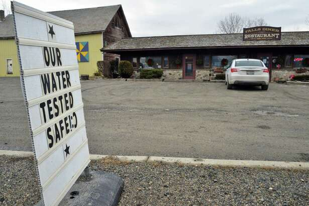 Sign in front of the Falls Diner restaurant Tuesday Jan. 26, 2016 in Hoosick Falls, NY.  A Health Department report said levels of PFOA that are considered safe for human consumption were found in several private wells, including at the Falls Diner restaurant on Route 22.  (John Carl D'Annibale / Times Union)