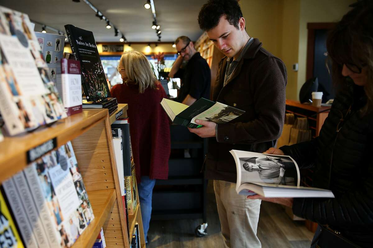 From right: Andy Cunningham and her son Cormac Siegfried check out books at the Book Passage on Tuesday, Feb. 7, 2017 in Sausalito, Calif. The bookstore is located on 100 Bay St. The two live nearby and came to check out the new bookstore.