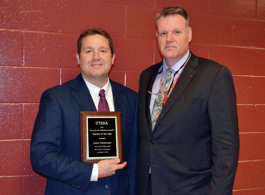 James Zambarano (left) received the Connecticut Engineernig Education Association Teacher of the Year award from CTEEA president William McDonough at New Canaan High School in New Canaan, CT on Feb. 6, 2017. Photo: Contributed Photo / Hearst Connecticut Media / New Canaan News