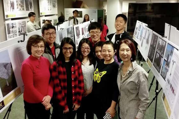 Julie Tang (left) and Lillian Sing (right) with Stanford students at an exhibit of memorial proposals. | PHOTO: COMFORT WOMEN JUSTICE COALITION/FACEBOOK