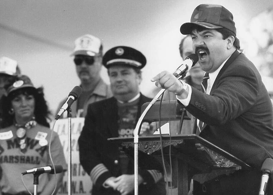 At right, Richard Trumka of the United Mine Workers of America stirs up members before a Sept. 25, 1989, march to Pittston Co., a coal mining company based in Greenwich. UMW, outraged over Pittston's termination of health care benefits for about 1,500 retirees, widows and disabled miners, went on strike from April 1989 to Feb. 20, 1990. Photo: Gregg Matthews /