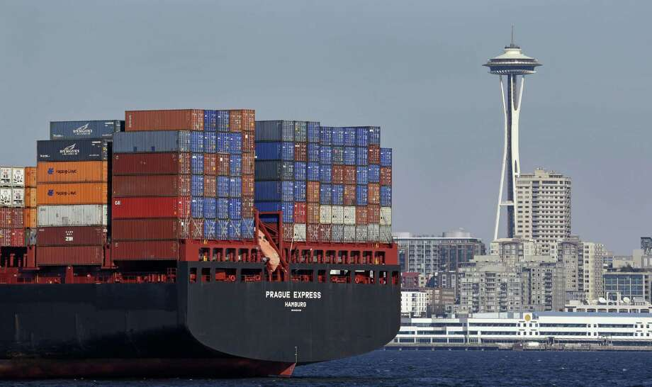 The U.S. trade deficit in December fell 3.2 percent to $44.2 billion, the Commerce Department reported Tuesday. A gain in exports of commercial aircraft, heavy machinery and autos offset a rise in imports. Photo: Associated Press /File Photo / Copyright 2016 The Associated Press. All rights reserved.