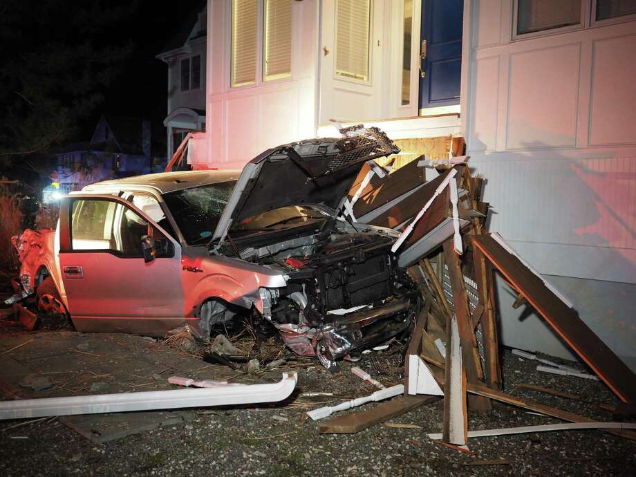 A pickup truck driven  by a Fairfield University student took out the front porch of a home on Fairfield Beach Road Sunday night. Fairfield,CT. 2/7/17 Photo: Contributed / Contributed Photo / Fairfield Citizen