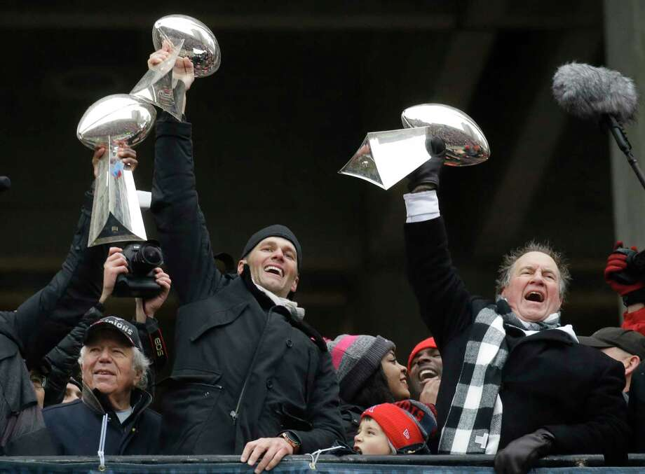 New England Patriots quarterback Tom Brady holds up Super Bowl trophies along with head coach Bill Belichick, right, and team owner Robert Kraft, left, during a rally Tuesday, Feb. 7, 2017, in Boston, to celebrate Sunday's 34-28 win over the Atlanta Falcons in the NFL Super Bowl 51 football game in Houston. (AP Photo/Elise Amendola) Photo: Elise Amendola, Associated Press / Copyright 2017 The Associated Press. All rights reserved.
