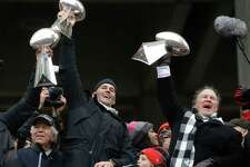 New England Patriots head coach Bill Belichick holds up a Super Bowl trophy as he addresses the crowd during a rally Tuesday, Feb. 7, 2017, in Boston, to celebrate Sunday's 34-28 win over the Atlanta Falcons in the NFL Super Bowl 51 football game in Houston. (AP Photo/Elise Amendola)