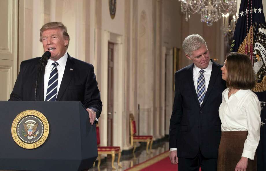 President Donald Trump introduces Judge Neil Gorsuch as his nominee to fill the vacancy on the Supreme Court, in the White House on Jan. 31. On the right is Gorsuch's wife, Louise. Photo: STEPHEN CROWLEY /NYT / NYTNS