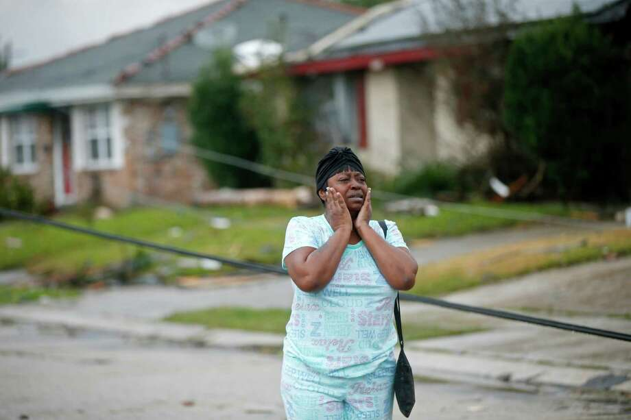 Lisa Carruth reacts as she surveys the damage after a tornado tore through the eastern part of New Orleans, Tuesday, Feb. 7, 2017.   The National Weather Service says at least three confirmed tornadoes have touched down, including one inside the New Orleans city limits. Buildings have been damaged and power lines are down. (AP Photo/Gerald Herbert) Photo: Gerald Herbert, STF / Copyright 2017 The Associated Press. All rights reserved.