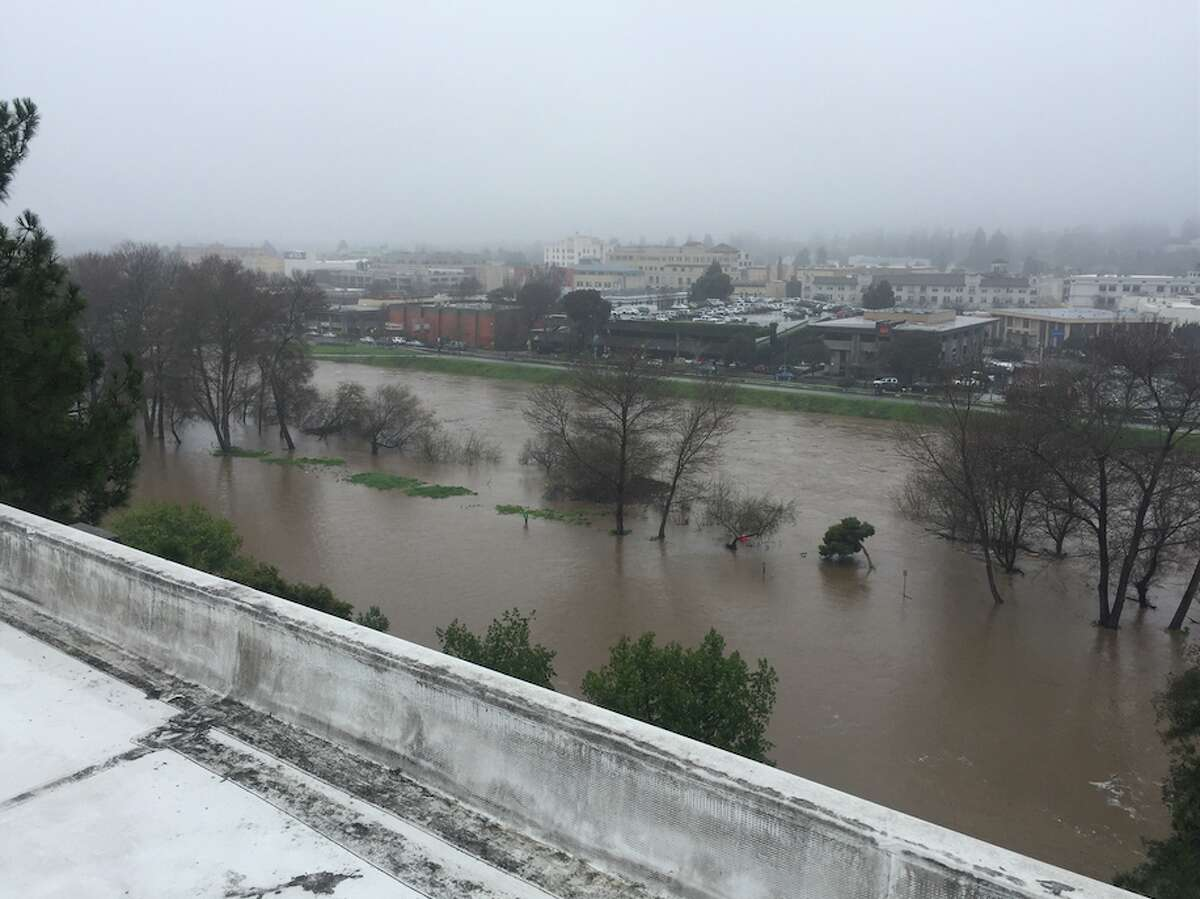 Photo of a swollen San Lorenzo River taken from the top of the County Governmental Building in downtown Santa Cruz on Feb. 7, 2017.