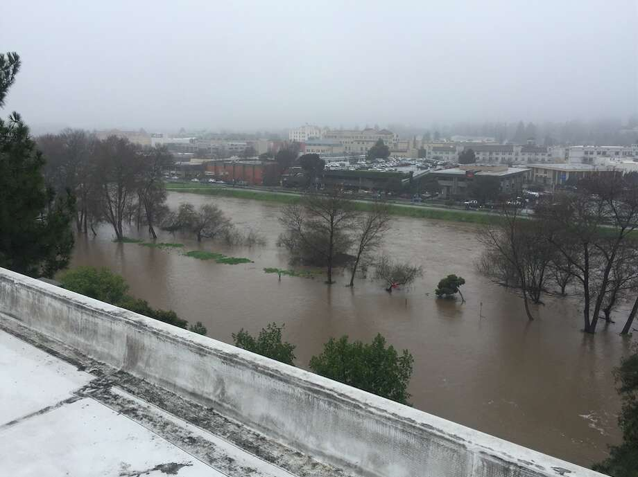 Photo of a swollen San Lorenzo River taken from the top of the County Governmental Building in downtown Santa Cruz on Feb. 7, 2017. Photo: Jason Hoppin