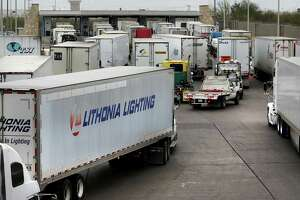 Trucks line up at the U.S. Customs and Border Protection checkpoint at the World Trade Bridge in Laredo.