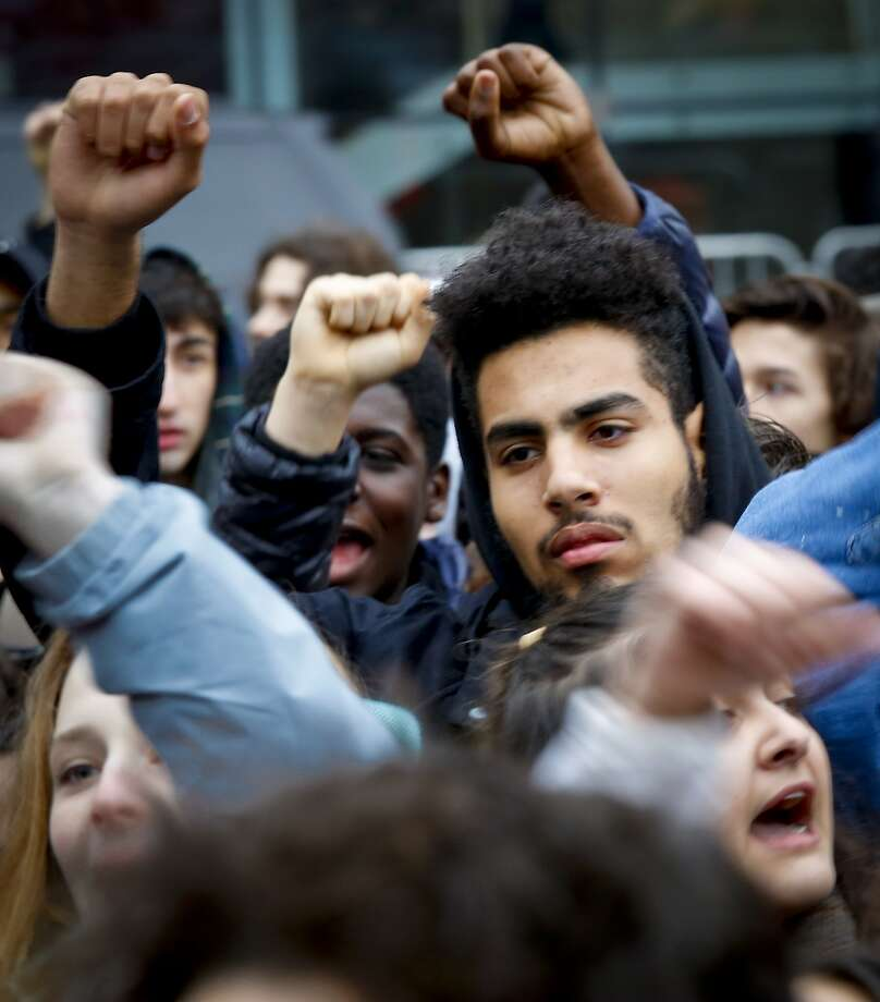 Students from high schools and colleges throughout New York city protest with clenched fists, during a rally against President Donald Trump's executive order banning travel from seven Muslim-majority nations, Tuesday Feb. 7, 2017, in New York's Foley Square. (AP Photo/Bebeto Matthews) Photo: Bebeto Matthews, Associated Press