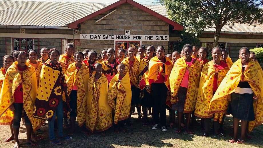 Girls pose at Kenya's Tasaru Safe House, where runaways can escape the tribal tradition of female genital mutilation. Photo: Kim Rosen