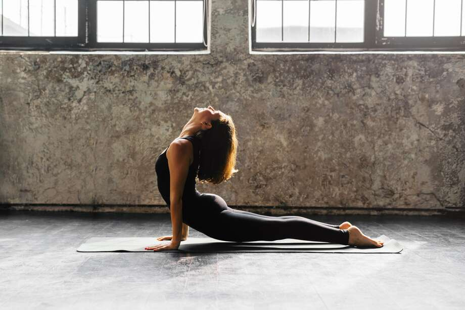 Woman does yoga. Photo: Getty Images
