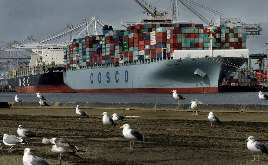 The Chinese container ship Cosco Glory waits to be unloaded this month in Oakland, Calif. Photo: Ben Margot, STF / Copyright 2017 The Associated Press. All rights reserved.