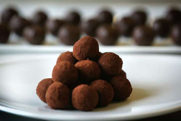 Chef Alain Dubernard, head of the baking and pastry department at the Culinary Institute of America-San Antonio, makes chocolate truffles on Monday, Feb. 6, 2017.