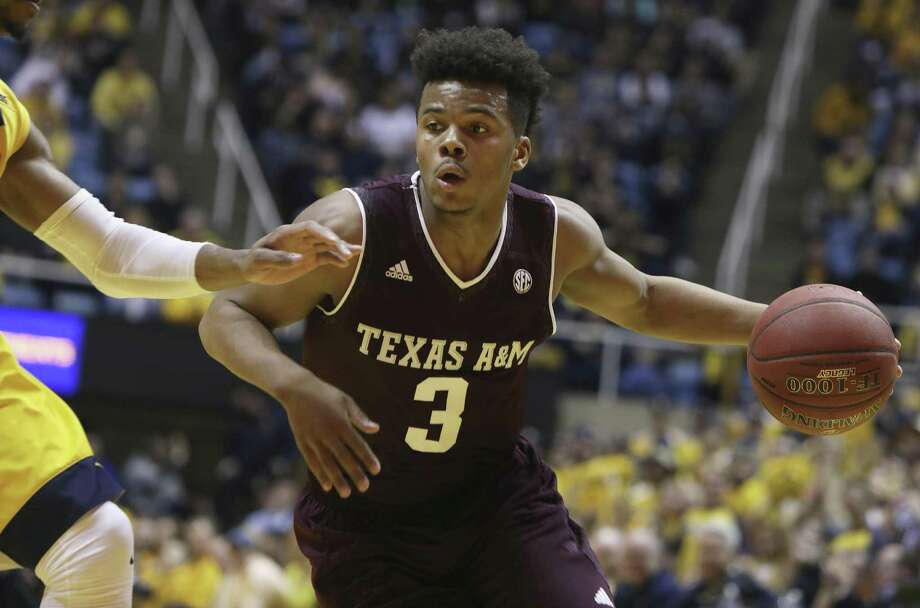 Texas A&M guard Admon Gilder (3) drives the ball up court during the first half at West Virginia on Jan. 28, 2017. Photo: Ray Thompson /Associated Press / FR171247 AP