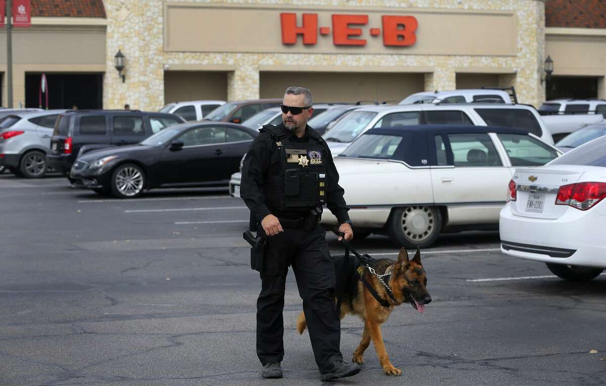 Security officer Justin Owen patrols Monday February 6, 2017 at the H-E-B Lincoln Heights store with a S.E.A.L. Security canine officer